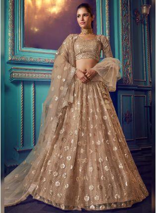 Decent Modish Beige Colored Soft Net Sequin And Zari Work Ethnic Lehenga Choli