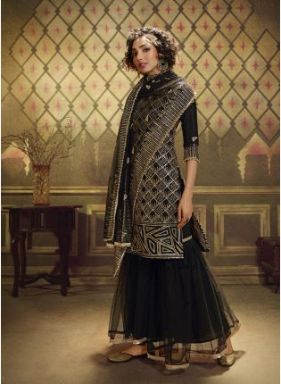 girl in Elegant Black Soft Net Salwar Suit.