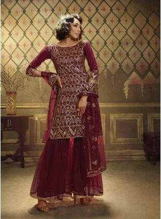 girl in Maroon Soft Net And Sequence suit