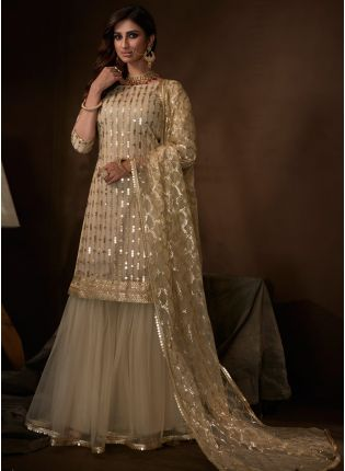 Shop Modish Ethnic Festive Wear Beige Color Soft Net Base Sharara Suit
