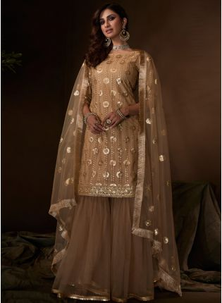 Iconic Sparkling Festive Wear Beige Colored Soft Net Base Sequin Sharara Suit