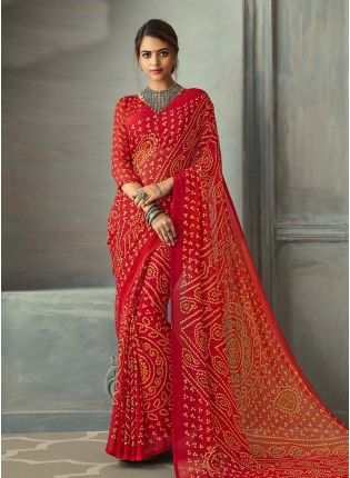 Remarkable red color bandhej printed chiffon base saree