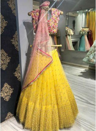 Trendy Yellow Sequin Soft Net Flared Ruffle Sangeet Lehenga Choli