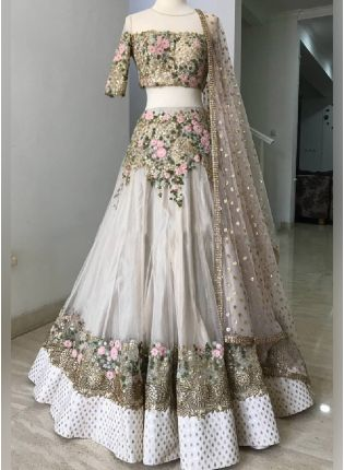 White Color Soft Net Base With Heavy Work Weeding Wear Lehenga Choli