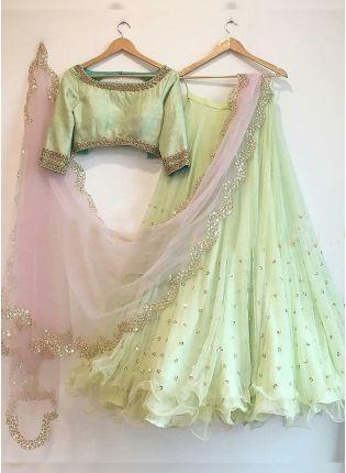 Splendid Pistachio Color Party Wear Net Base Full Flared Lehenga Choli