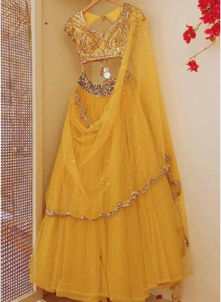 Trendy Elegant Mustard Yellow Soft Net Base Flared Lehenga Choli For Your Haldi Function