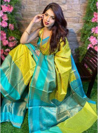 girl in Yellow Teal Blue Silk Waving Saree