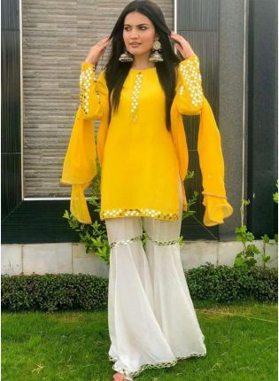 girl in Sunny Yellow Georgette and Foil Print Sharara Suit