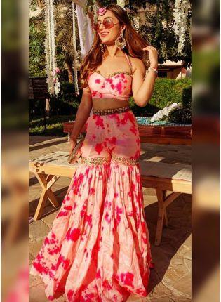 girl in Florid Pink Silk Sharara Suit