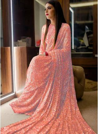 girl in Peach Sequin Georgette Embroidered Party Wear Saree