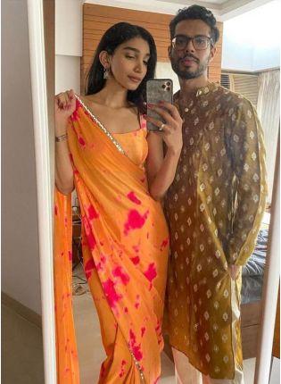 Glamorous Orange Color Silk Base Bollywood Saree