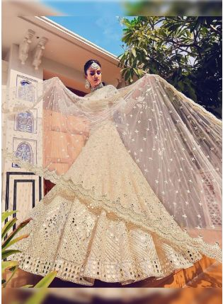Glamorous Beige Color Soft Net Flared Lehenga Choli
