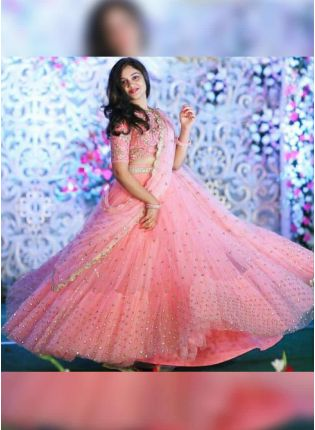Affordable Unbeatable Peach Pink Soft Net Flared Sangeet Wear Lehenga Choli