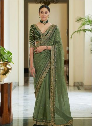 Glamorous Green Colored Pure Organza Silk Base Saree With Blouse Piece