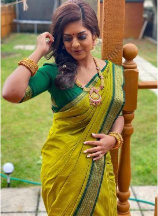 Glamorous Look Parrot Green Color Saree With Weaving Dark Green Color Border Saree