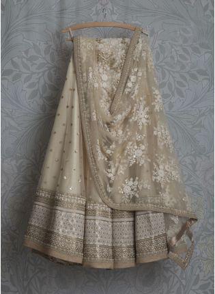 Glamourous Wedding Wear Beige Net Lehenga Choli