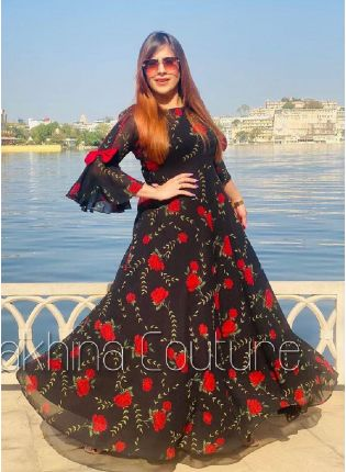 Glamorous Look Black Color Georgette Base With Red Color Flower Print Base Gown
