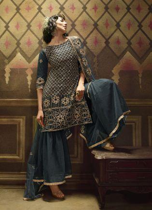 Emerald Green Soft Net And Sequins Sharara Salwar Suit.
