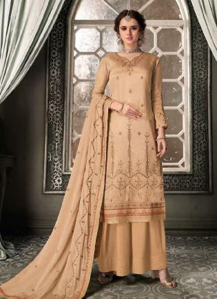 Pleasing Cream Color With Heavy Embroidery Work Salwar Kameez