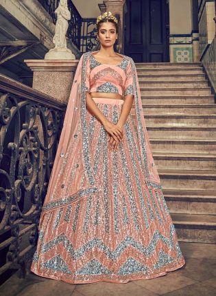 Attractive Soft Net Fabric Peach Color Sequins Work Lehenga Choli