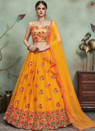 Delightful Yellow Color Soft Net Base Heavy Thread And Sequins Work Lehenga Choli