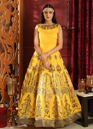 Elegant Bright Yellow Silk Designer Gown With Metallic Foil Print