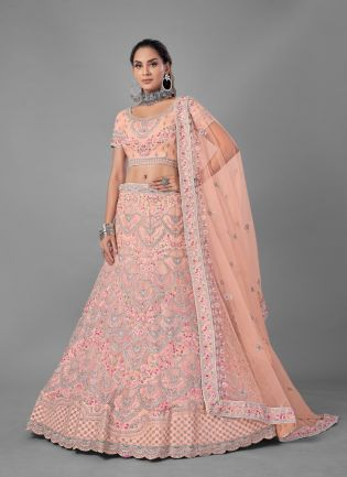 Exquisite Peach Color Soft Net Base With Heavy Work Bridal Wear Lehenga Choli