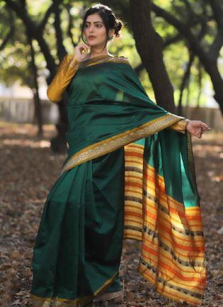 Eye-captivating Bottle Green Color Silk Base Banarasi Saree