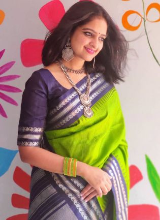 Fabulous Parrot Green Color Soft Silk Base Ceremonial Wear Saree With Navy Blue Color Blouse