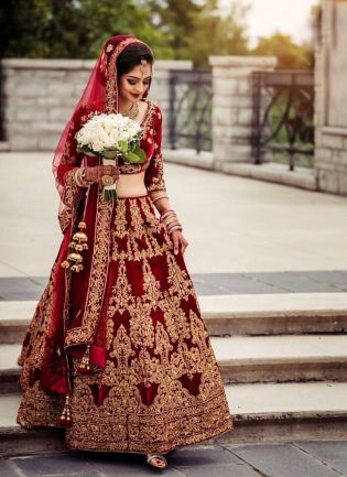 Glamorous Red Color Velvet Base Embroidery Work Lehenga With Matching Blouse