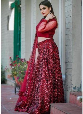 Lovely Maroon Sequined Soft Net Flared Lehenga Choli Set