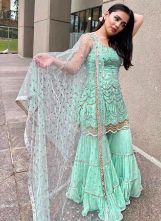 Enticing Sea Green Color With Embroidery Hand Work Sharara Suit