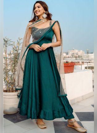 Glamorous Turquoise Color Silk Base Anarkali Suit
