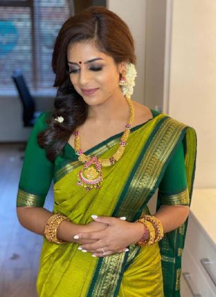 Trendy Green Color Kanchipuram Silk Base Ceremonial Wear Saree With Contrast Color Blouse