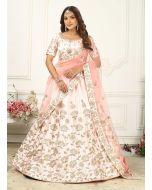 Light Peach Color Silk Fabric Zari Work Flared Lehenga Choli With Dupatta